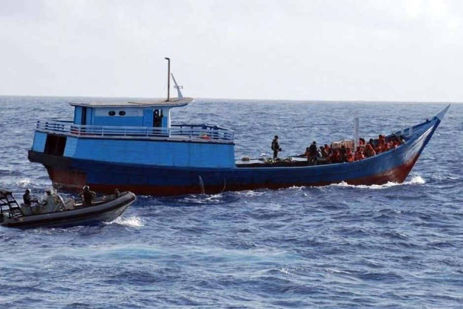 The Australian Navy intercepts a boat carrying asylum seekers north of Australia