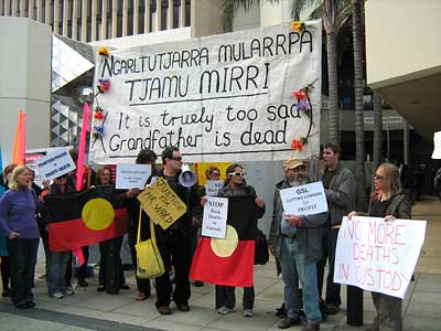 Citizens protest in front of the Perth Central Law Courts where Coronor Alastair Hope delivers his findings