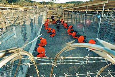 detainees crouch at the Guantanamo Bay detention centre