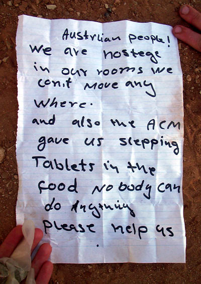 Cries for Help: a note thrown over the Woomera Fence during the Woomera protests in 2002